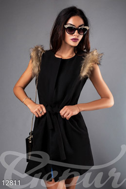 The vest with fur on the sleeves photo 1
