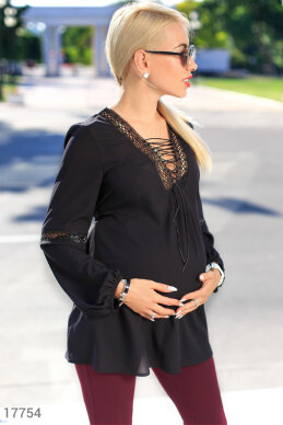 Loose blouse pregnant photo 1