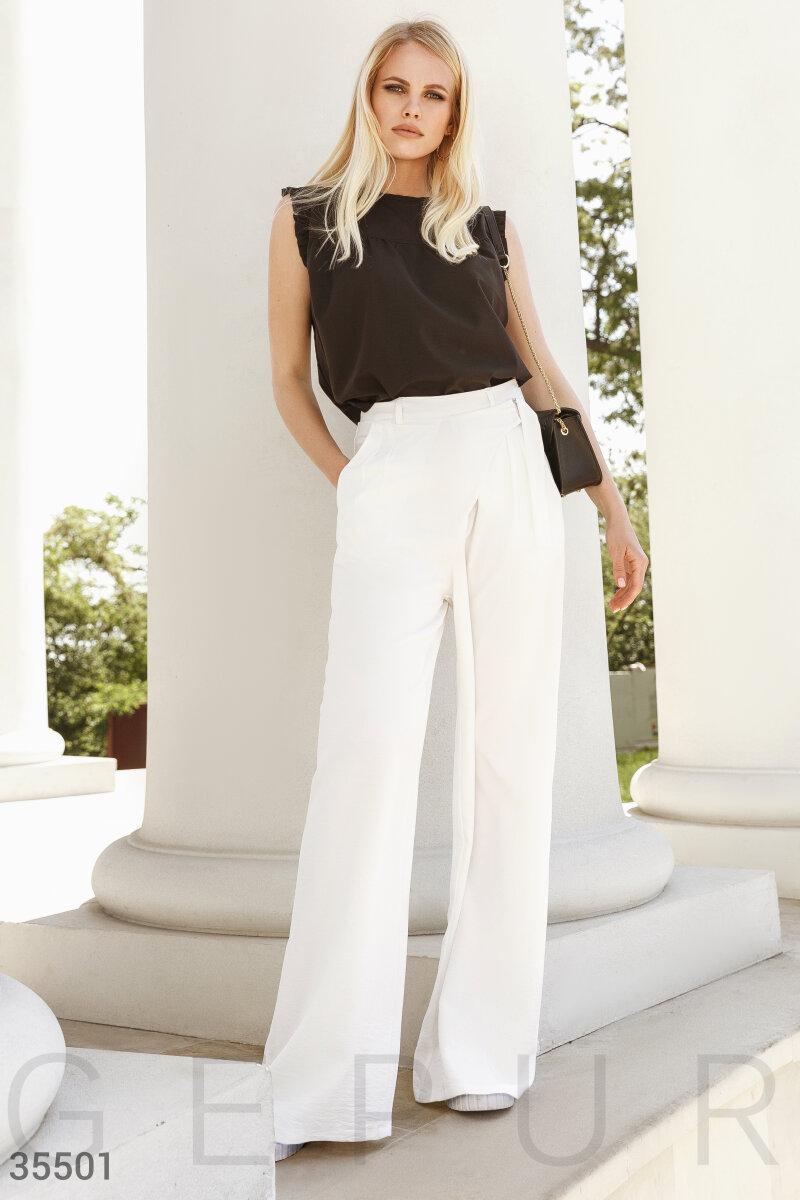 Белые брюки-палаццо с запа́хом