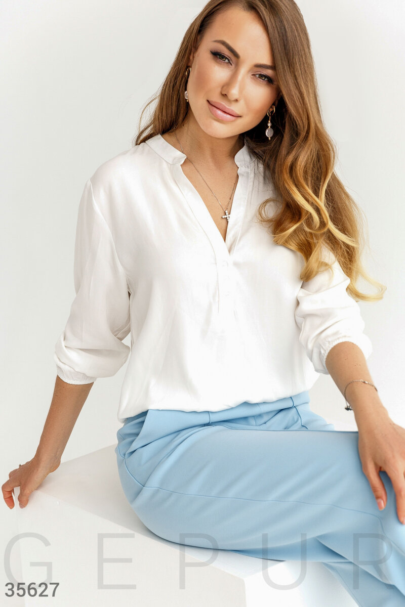 Белая блуза из хлопковой ткани